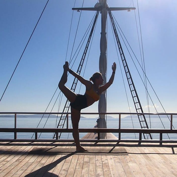 A Calming Yoga Session in the Deck of Komodo Liveaboard
